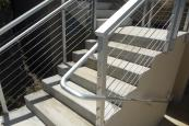 stairway with aluminum framed and stainless steel cable rail